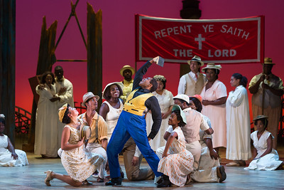 """Frederick Ballentine as Sportin' Life with members of the ensemble in The Glimmerglass Festival's 2017 production of The Gershwins' """"Porgy and Bess."""" Photo: Karli Cadel/The Glimmerglass Festival"""