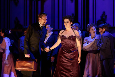 "Wm. Clay Thompson as Doctor Grenvil, Amanda Woodbury as Violetta and members of the ensemble in The Glimmerglass Festival's 2019 production of ""La traviata."" Photo: Karli Cadel/The Glimmerglass Festival"