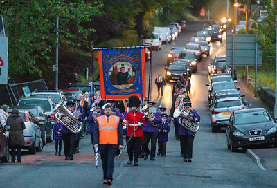 The new banner is paraded from Brown's field to Newtownbutler Orange Hall.  Picture: Ronan McGrade