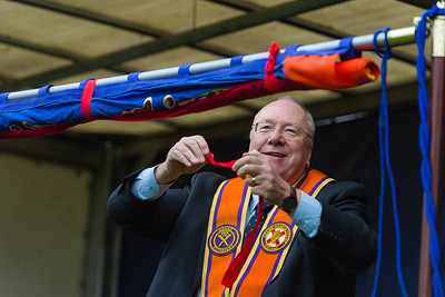 Worshipful Brother Rev Mervyn Gibson, the Grand Secretary of the Grand Orange Lodge of Ireland, unfurls the banner.  Picture: Ronan McGrade