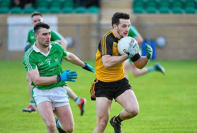 Thomas McCaffrey of Erne Gaels makes a break past Roslea's Niall Beggan.  Picture: Ronan McGrade