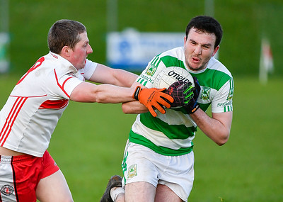 Teemore's Liam Martin breaks past Ryan Daly of St Pats.  Picture: Ronan McGrade