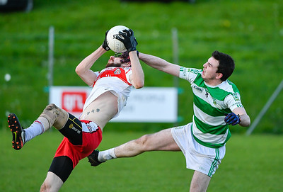 Paul Cosgrove of St Pats and Teemore's Liam Martin get to grips with each other in midfield.  Picture: Ronan McGrade