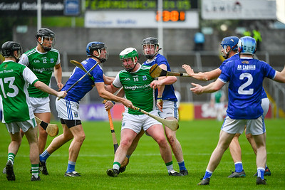 Eoin Cleary comes under pressure from the Cavan back line.  Photo: Ronan McGrade