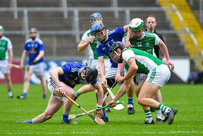 Nathan Timoney and Eoin Cleary attempt to free the ball from Cavan's Caolan Kelly.  Photo: Ronan McGrade