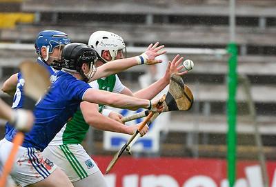 Both sides chase the loose ball.  Photo: Ronan McGrade