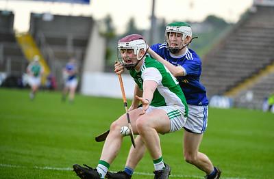 Barry McPhillips reaches for the loose ball.  Photo: Ronan McGrade