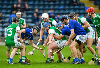 Fermanagh's John Duffy stretches for the sliothar in the melee.  Photo: Ronan McGrade