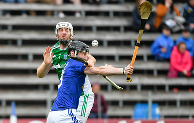 Fermanagh's Mark Slevin challenges for the ball.  Photo: Ronan McGrade