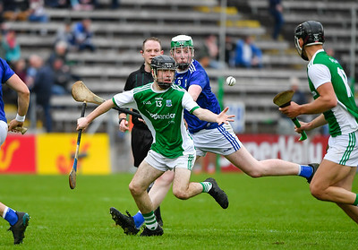Caolan Duffy gathers possession as Cavan's Diarmaid Carney closes in.  Photo: Ronan McGrade