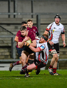 Gareth Beatty holds on to the ball as the Enniskillen line gains ground.  Picture: Ronan McGrade