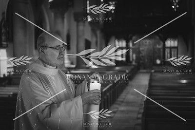 Monsignor Peter O'Reilly leads an Easter Vigil mass at St Michael's Church, Enniskillen on 11th April 2020.  Picture: Ronan McGrade