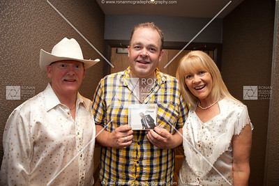Anthony McBrien with singing duo, Ally & Marion.