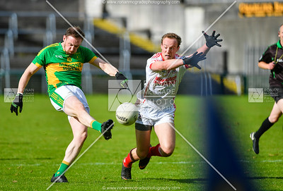 Lee Cullen gets the block in as Irvinestown go on the attack.  Picture: Ronan McGrade