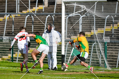 Garvin Quigley slots the ball past Irvinestown's TJ McMulkin from close range late in the game to seal victory for Belnaleck.  Picture: Ronan McGrade