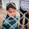 Chios February 2016: Five year old Farshad from Afghanistan is kept detained at Chios in Greece together with his family while they are waiting for a chance to seek asylum. Photo: Tiril Skarstein/NRC<br /> <br /> Interview with his sister Yasmin (16) - from Afghanistan:<br /> The situation here is very bad. When we ask the police when we can get out, they say they do not know. <br /> Some people say maybe one month, maybe two months, maybe more. <br /> Why are we kept imprisoned, when we have done nothing wrong? It is very bad. We have been here for many weeks now. Since 20 March. <br /> <br /> We want to apply for asylum. We do not want to be deported back to Turkey. Many people have been deported. <br /> We do not know when we can get out of this prison. It is like a prison. We cannot get out of here. <br /> I wish we could at least be able to go around freely.<br /> We just want to have security and peace, and be able to study in a safe place. To become a person. <br /> We want freedom. <br /> I like to say to European politicians that this agreement is a bad agreement. It does not treat us like humans. <br /> We need protection. Why are people deporting us back to Turkey? There´s no life for us, no security for us there.