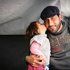 Chios April 2016: Jamal and Asinat (2) at Depethe camp at Chios, Greece (open facility). Photo: Tiril Skarstein, NRC.<br /> <br /> Interview with Jamal - fleeing with his wife and their child Asinat (2).<br /> Planes were bombing our neighbourhood. One bomb hit our home and I had an injury in the stomach and I was taken to hospital where I had an operation. My wife was also hit in her shoulder. But luckily I was able to shield Asinat (2). It was during the previous Ramadan. We decided we need to get to safety in Europe. The travel has been very difficult, both to cross from Syria to Turkey and across the sea to get to Greece. We have been close to death. <br /> <br /> We escaped form the war, but here in Greece we were taken to a detention center. We have no rights here. We escaped the war, but for what? I have friend in Oslo and other parts of Europe and they tell me that their rights are respected - but here we have no rights and there´s no humanity.<br /> I am afraid we will be sent back to Turkey. There is no life for us there. <br /> In Syria we would die quickly, here we are dying slowly. In Syria we would be killed in the war, here the despair is strangling us. <br /> <br /> See also video interview.