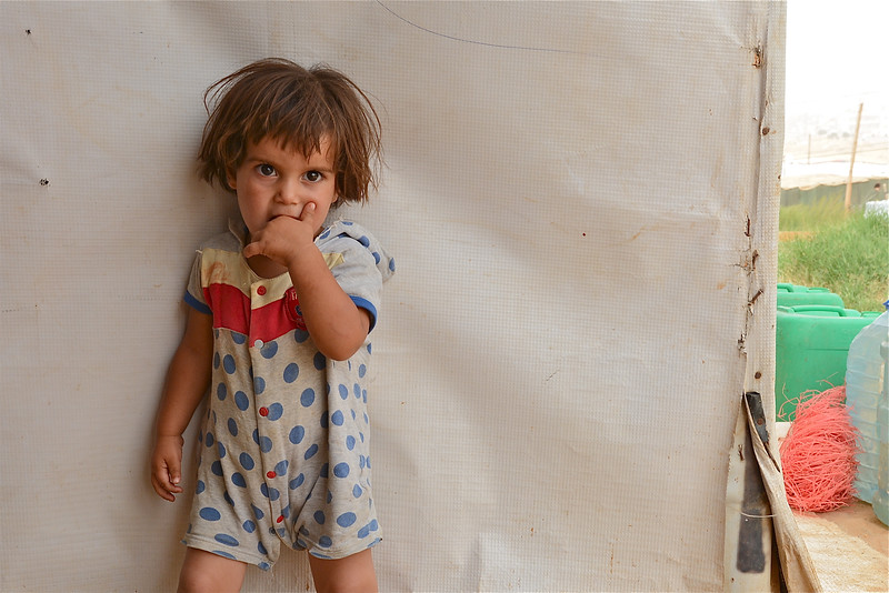 Bayan (2) from Hama, Syria, has fled the war and is now living in an informal tented settlement in Bekaa in Lebanon. Photo: Tiril Skarstein/NRC