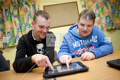 John Swift and Joseph Maguire play a game on the iPad.