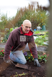 Duncan Cathers weeds a herb bed.