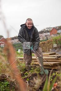Brendan Farmer digs up his last crop of potatoes.