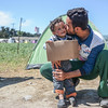 Mustafa has fled from Aleppo, and is currently at Idomeni in Greece. Here he is playing with his nephew Hisham (3). Photo: Tiril Skarstein, NRC