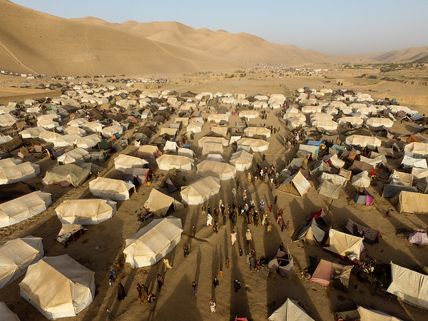 This is Kharestan IDP settlement some 6km out of Qala-e-naw city. According to recent assessment by OCHA, 4,787hh are living in this settlement. IDPs from Muqur, and BalaMurghab districts have settled here and some have moved from Qala-e-naw surrounding villages. These people were saying that there is no more water in their villages and they had to move somewhere. <br /> NRC with support from Sida distributed 200 tents in this settlement. During an early visit from the settlement we found most of the tents occupied. Photo: NRC/Enayatullah Azad