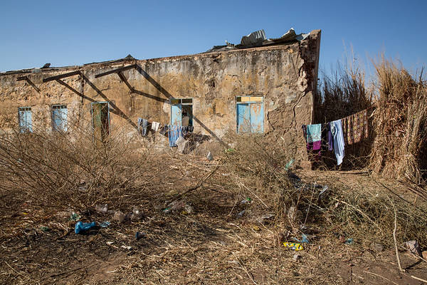 15  people are seeking shelter in what used to be a school from when Um Rakuba camp was last open and hosted Ethiopian refugees during the big famine in the 1980s. The roof is partly damaged and  the living conditions for the refugees are dire. <br /> <br /> Photo: Ingebjørg Kårstad/NRC