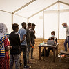 Refugees line up to receive cash assistance as an emergency measure to help them the first days after arrival in the camp. <br /> <br /> <br /> Um Rakuba refugee camp on 2 December 2020. The camp is located 70 kilometers from the Ethiopian border inside eastern Sudan. It currently hosts some 10,000 Ethiopia refugees, who have fled fighting in Ethiopia's Tigray region over the past month. Jan Egeland, Secretary General of the Norwegian Refugee Council (NRC), was on the ground in the camp speaking with families who had fled the violence. NRC has set up emergency schooling for children displaced by the violence. Already a school for 700 children is up and running after five days operating in the camp.<br /> <br /> Copyright: Ingebjørg Kårstad / Norwegian Refugee Council