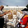 Secretary general of NRC, Jan Egeland, watching food drop and meeting idps receiving food distribution from NRC and WFP.<br /> Photo: Tuva Raanes Bogsnes/NRC <br /> <br /> <br /> dav
