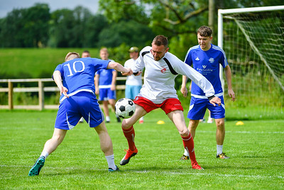 Steven Craig brings the ball under control in midfield.  Photo by Ronan McGrade