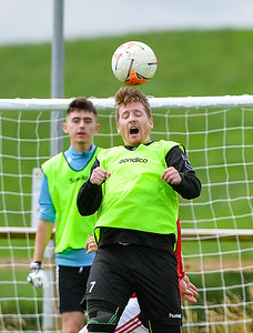 Stephen Callaghan gets his head to the ball.  Photo by Ronan McGrade