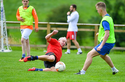 Jack Mulligan wins the ball with this slide tackle.  Photo by Ronan McGrade
