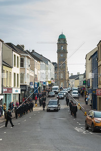 John McConnell's remains are brought through the centre of Enniskillen.