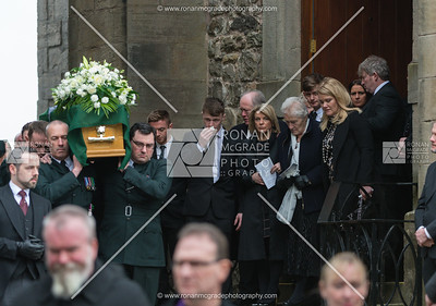 John McConnell's wife Shirley, his sons James and Alex and his mother Evelyn lead mourners out of St Macartin's Cathedral.