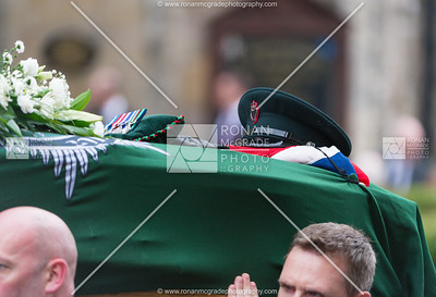 John McConnell's hat, gloves and medals were laid on his coffin.
