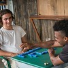"Nilson is teaching Marlon Langeland how to play Domino.<br /> <br /> Nilson, a 22 year old boy survived a massacre in his village. After the massacre he and his family had to flee. Unfortunately, one of his brothers and three male cousins where killed in the massacre. <br /> <br /> Nilson grew up in a small village along the river in the region of Chocó, Colombia. He loved playing games, go swimming and fishing with his friends. He was studying at school and life was good. His dream got tossed when the community repetitively was threatened and they eventually had to flee. <br /> <br /> The massacre<br /> It was an ordinary day in March 2017. The women of the village were celebration women's day. Nilson and many other males in the small village was doing their daily activities including fishing, playing and walking around when all of a sudden an armed group attacked. ""Suddenly people that we had never seen before appeared. They were armed and attacked everyone they came across. They looked angry. They did not speak with anyone; they just stared at people in silence and killed everyone they caught"". Five male youth got killed.<br /> <br /> Today, the village is abandon and appears more like a ghost town. Nilson and his family are now too afraid to return to their village because of the uncertainty that follows and if another massacre will happen again.<br /> <br /> Life today<br /> Nilson has now problems with adapting to his new life after the massacre and loss of his brother and three cousins and he has lost his desire to do things he used to like. ""Things are not the same. Things that I used to do there I now avoid doing here. Sometimes I do not feel well, I feel uncomfortable, because of the things that have changed so much"". He has stopped studying and many of his old friends and relatives have moved elsewhere. <br /> <br /> Despite all this, he feels safe in the village they are displaced and now trying to adapt their new life. ""I am overcoming some things and I feel calm and relaxed. I feel no fear"". He often reflects on the things that did happen and feels sad and occasionally also cries. However, on the contrary, the feeling of anxiety and stress also makes him want to run. <br /> <br /> Above all, he would like to continue his education. As he says ""the truth is that I am in limbo. I am not doing anything about it so I do not feel well"". He wants to become a pilot. He would also like to have family with a wife and children, a good house and even a dog.<br /> <br /> Photo: Beate Simarud/NRC<br /> <br /> NRC in Colombia:<br /> -	NRC has been present in Colombia since 1991.<br /> -	NRC currently counts on 19 field offices in order to provide assistance to internally displaced and Colombians seeking international protection in the neighbouring countries. <br /> -	About 100.000 people benefited in 2017 from NRC´s programs (information, counselling and legal assistance (ICLA), education, regional refugee program and the roving capacity unit). Budget forecast 2017: 97.6 million NOK<br /> -	Strategic priority for 2018 continues to be to address displacement and emergency related protection gaps and humanitarian need when the state is unable or unwilling to fulfil its obligations. The peace accord will increase the likelihood that durable solutions can be sought with more vigour. NRC will in this context increase efforts to contribute to durable solutions, both in Colombia and in neighbouring countries. <br /> <br /> Key facts:<br /> •	Humanitarian and protection challenges continue in Colombia. A six decade-long armed conflict has given Colombia the most prolonged and serious humanitarian crisis in the Americas. In total, more than 7.4 million people are forcibly displaced in Colombia by the conflict.<br /> •	Since the signing of a peace agreement between FARC-EP and the government in November 2016, about 200,000 people have been displaced (nov 2016 – august 2018) – the equivalent of one person every 5 minutes. Rights defenders, indigenous and Afro- Colombian leaders, and other community activists face threats, killings and violence. Perpetrators are rarely held accountable.  <br /> •	There are more than 191,622 Colombians refugees and in need of international protection in neighbouring Ecuador, Panamá and Venezuela, according to UNCHR.<br /> •	Forced displacement increased in 2018. During the first semester group displacement increased 112 % in comparison with the previous year (2017). <br /> •	During 2018, there was an increase (31 %) in the number of attacks against the civilian population, compared with 2017. Threats continue to be the primary mean of attack against the civilian population, although there was a growth in the number of homicides and intentional injuries targeting persons who were under state protection schemes.<br /> •	9 in 10 people displaced by Colombia's civil war have not yet received compensation promised for crimes committed against them. Over 8,7 million Colombians are registered with the Government's National Unit for Victims. However, only one out three applications for compensation by the 2011 Victim's Law in Colombia has been approved. Despite GOC efforts allocating important resources ensure the implementation of the law, the efforts needs to be increased. <br /> •	During 2018, 77 % of the people recorded in massive displacement events belongs to farmers, 11 % indigenous and 11 % afro Colombian communities.  <br /> •	The peace agreement between FARC-EP and the Colombian government is a positive development, but the dynamics of armed conflict and other forms of violence are in flux. Other irregular armed groups have increased their actions in the shadow of the ceasefire, and the clash with these groups is causing the majority of new humanitarian needs.<br /> •	NRC recorded 22 events that affected the continuity of thousands of children attending classes during the first trimester of 2018. 7 IHL serious violations against schools have been reported in the first semester of 2018 and forced recruitment into armed groups appear to increase this year.<br /> •	Of the total resources requested (156.5 Millions) by the Country Humanitarian Team, only 22 % has been financed (OCHA July 2018)"