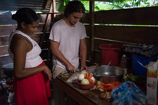 "Marlon Langeland and Jhoana are cooking traditional Colombian dinner.<br /> <br /> Jhoana, 20 years old, and her family had to flee after an armed attack in her village. Two of her brothers and her two cousins where killed. All male youth.<br /> <br /> Jhoana grew up in a small village along the river in the region of Chocó, Colombia. She loved playing with her siblings and cousins, walking in the bush and went swimming. Her dream was to study veterinarian because her passion for animals. Her dream got tossed when the community repetitively was threatened and they eventually had to flee.<br /> <br /> Armed attack<br /> It was an ordinary day in March 2017 when Jhoana and other women were celebrating women's day. The remaining village, mostly males, continued their normal activities when all of a sudden an armed group attacked. That night Jhoana couldn't sleep due to nightmares and not knowing the extent of the attack and not being able to go back to the village before the next day.<br /> <br /> The next day they witnessed several dead and wounded youths and she was devastated. Not one, but two of her elderly brothers had lost their lives. One where tied up and the other one was laying dead on a rooftop with rain poring down on the body. Furthermore, two cousins and a family friend, all young, and all males also lost their life's. <br /> <br /> Today, the village is abandon and appears more like a ghost town. Jhoana and her family are now too afraid to return to their village because of the uncertainty that follows and if another armed attack will happen again.<br /> <br /> Life today<br /> Now, her daily activities are restricted to short trips; when she leaves the house, she does not go far and she coordinates her trips with relatives. A common daily activity can consist of meeting her cousins at the pier and watch them swim. Or, she will only hang out in their house. At home, where she spends most of her time, she writes her diary to cope with the armed attack and the loss of her two older brothers. She also does her homework in secondary school, or, she helps her mom with cooking and takes care of her 12-year-old niece, Yurani, that lost her dad in the armed attack. She now feels that she has to support her family because her parents are old and the two oldest brothers are gone. <br /> <br /> She continuously strives to stay positive and cope with the armed attack. ""With the heart broken I have to be brave. Forget bad things and bring positive things. Even with this pain, I want to get ahead. I have to fight for positive things to happen"".<br /> <br /> Hopes for the future<br /> The only way she can fulfil her dream and help her family is to leave the village and continue studying, but there is no money to study for. ""I now have a 12-year old niece and I would like to be a good example for her. My nieces father was killed in the armed attack and her mother died due to illness prior. Thus, if I go on to study and build my life I will then get a good job and she will hopefully acquire strength to achieve the same"". <br /> <br /> Jhoana is hoping for peace in Colombia, but she is not sure if that will happen. She has realized that there is no future in the village she is displaced and the road is unfortunately short for youth to armed groups and drugs. Thus, she believes the path lies in education and underline the importance to reach a common agreement in peace in order to progress the country. <br /> <br /> Message to youth<br /> ""If you want something you can achieve it, therefore you should proceed it"". ""Even if someone hurts you, you have to be strong and get ahead"". She continues, ""while you are alive you have to be brave, even if you smile outside and cry inside we should proceed with our dreams"". <br /> <br /> ""Don't believe in negative things, don't fall into bad vicious, be ambitious in a positive matter, and fight for the future and don't be defeated"".<br /> <br /> Photo: Beate Simarud/NRC<br /> <br /> NRC in Colombia<br /> <br /> -	NRC has been present in Colombia since 1991.<br /> -	NRC currently counts on 19 field offices in order to provide assistance to internally displaced and Colombians seeking international protection in the neighbouring countries. <br /> -	About 100.000 people benefited in 2017 from NRC´s programs (information, counselling and legal assistance (ICLA), education, regional refugee program and the roving capacity unit). Budget forecast 2017: 97.6 million NOK<br /> -	Strategic priority for 2018 continues to be to address displacement and emergency related protection gaps and humanitarian need when the state is unable or unwilling to fulfil its obligations. The peace accord will increase the likelihood that durable solutions can be sought with more vigour. NRC will in this context increase efforts to contribute to durable solutions, both in Colombia and in neighbouring countries. <br /> <br /> Key facts<br /> •	Humanitarian and protection challenges continue in Colombia. A six decade-long armed conflict has given Colombia the most prolonged and serious humanitarian crisis in the Americas. In total, more than 7.4 million people are forcibly displaced in Colombia by the conflict.<br /> •	Since the signing of a peace agreement between FARC-EP and the government in November 2016, about 200,000 people have been displaced (nov 2016 – august 2018) – the equivalent of one person every 5 minutes. Rights defenders, indigenous and Afro- Colombian leaders, and other community activists face threats, killings and violence. Perpetrators are rarely held accountable.  <br /> •	There are more than 191,622 Colombians refugees and in need of international protection in neighbouring Ecuador, Panamá and Venezuela, according to UNCHR.<br /> •	Forced displacement increased in 2018. During the first semester group displacement increased 112 % in comparison with the previous year (2017). <br /> •	During 2018, there was an increase (31 %) in the number of attacks against the civilian population, compared with 2017. Threats continue to be the primary mean of attack against the civilian population, although there was a growth in the number of homicides and intentional injuries targeting persons who were under state protection schemes.<br /> •	9 in 10 people displaced by Colombia's civil war have not yet received compensation promised for crimes committed against them. Over 8,7 million Colombians are registered with the Government's National Unit for Victims. However, only one out three applications for compensation by the 2011 Victim's Law in Colombia has been approved. Despite GOC efforts allocating important resources ensure the implementation of the law, the efforts needs to be increased. <br /> •	During 2018, 77 % of the people recorded in massive displacement events belongs to farmers, 11 % indigenous and 11 % afro Colombian communities.  <br /> •	The peace agreement between FARC-EP and the Colombian government is a positive development, but the dynamics of armed conflict and other forms of violence are in flux. Other irregular armed groups have increased their actions in the shadow of the ceasefire, and the clash with these groups is causing the majority of new humanitarian needs.<br /> •	NRC recorded 22 events that affected the continuity of thousands of children attending classes during the first trimester of 2018. 7 IHL serious violations against schools have been reported in the first semester of 2018 and forced recruitment into armed groups  appear to increase this year.<br /> •	Of the total resources requested (156.5 Millions) by the Country Humanitarian Team, only 22 % has been financed (OCHA July 2018)"