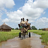 Three boys from near the city of Aweil in South Sudan, carry their belongings on a cart out of floodwater.  (Photo:<br /> UNMISS Photo/Staton Winter)