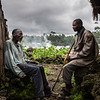 3. DR Congo - Bahamwite discussing with his old friend between their huts in Kishanga displacement camp