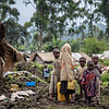 6. DR Congo - Noella's children looking for food and water in Kishanga camp