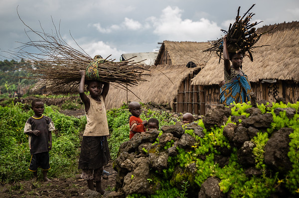 1. DR Congo - Anne and her children carrying wood sticks to make fire
