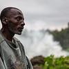 1. DR Congo - Bahamwite talking with his neighbour between huts in Kishanga displacement camp