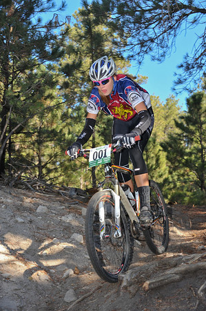 Laurel Rathbun (Highlander Composite) tackles sandy descent on Varsity course. Photo Paul Magnuson.