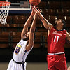 Photo by Greg Eans, Messenger-Inquirer.com | geans@messenger-inquirer.com<br /> <br /> Kentucky Thoroughbreds' Ken-Jah Bosley, left, and Ohio Cardinals' Michael Porrini (11) fight for a rebound during action at the Owensboro Sportscenter.