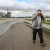 "Photo by Greg Eans, Messenger-Inquirer.com | geans@messenger-inquirer.com<br /> <br /> While making rounds throughout the county to assess flood levels, Andy Ball, Daviess County Emergency Management Agency director, reports on the water level flowing over Oakford Road, just off of U.S. Hwy 60 near Stanley. According to Ball, the water had only receded about a foot since Wednesday. ""We're still getting people driving through it and that's a concern,"" Ball said."