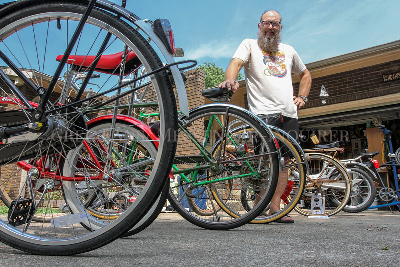 Photo by Greg Eans, Messenger-Inquirer.com/geans@messenger-inquirer.com<br /> <br /> Doug Mittelberg stands among a few of his collectable bicycles in the driveway at his home in Lewisport.