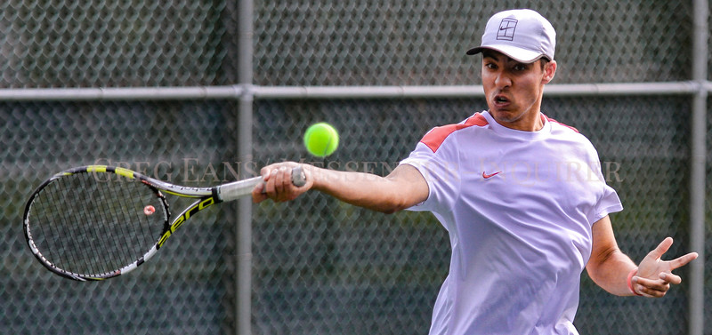 Photo by Greg Eans, Messenger-Inquirer.com | geans@messenger-inquirer.com<br /> <br /> Daviess County's Chris Salamah plays in the second set during doubles action against Owensboro Catholic during 3rd Region Tournament play at Moreland Park.