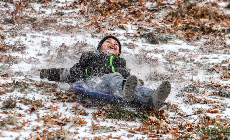 Photo by Greg Eans, Messenger-Inquirer.com/geans@messenger-inquirer.com<br /> <br /> Resse Rodriquez, 6, enjoys the wintry weather on Friday, sledding down the ice covered hill at Chautauqua Park in Owensboro. Rodriquez was at the park with his father, Eder Rodriquez.