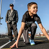 Photo by Greg Eans, Messenger-Inquirer.com | geans@messenger-inquirer.com<br /> <br /> King Combest, 10, gets some coaching from his father, Casey Combest, during a workout at the Owensboro Middle School track.